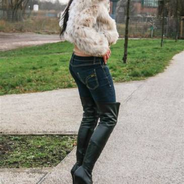 Fur jacket and Pleaser over-knee boots