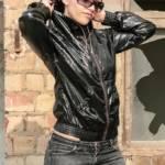 Shiny nylon jacket and black spandex string leotard