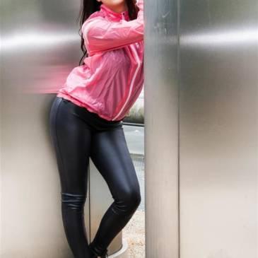 Leather leggings and shiny nylon windbreaker