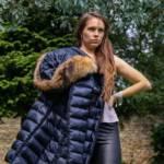 Megan in a blue shiny Moncler down coat