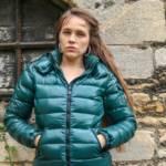 Megan in a green shiny Moncler