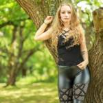 Blonde goth girl outdoor in shiny spandex leggings