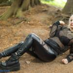Gothic girl in black leather leggings and platform boots