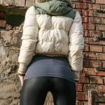 Southpole down jacket green and beige color with black shiny spandex leggings - backside view