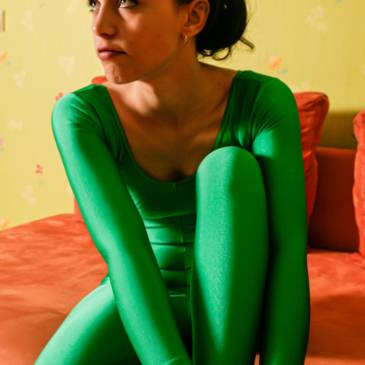 Green spandex catsuit girl